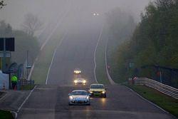 Early morning race action on the Döttinger Höhe: #236 Team DMV Porsche Cayman S: Ivan Jacoma, Nicola Bravetti, Matteo Cassina, André Krumbach