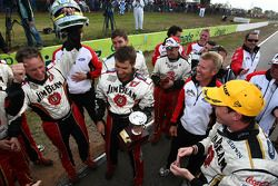 James Courtney celebrates with his team after taking out race 12 of the 2010 V8 Supercar Championshi
