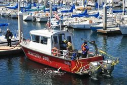 Monterey Fire Department attending to boat fire in Monterey Wharf