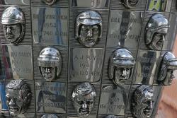 Faces of A.J. Foyt Jr, Bill Vukovich, Jim Rathmann, Roger Ward, Bobby Unser & Mario Andretti sit on the Borg Warner Trophy