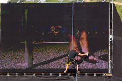 A worker cleans up the giant screen