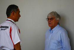 Hiroshi Yasukawa Bridgestone Director of Motorsport with Bernie Ecclestone CEO Formula One Group