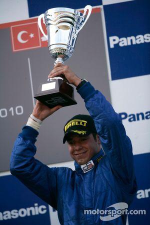 Felipe Guimaraes celebrates on the podium