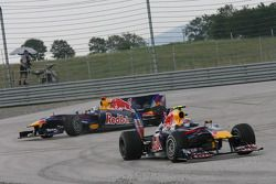 Mark Webber, Red Bull Racing drives off after his crash with Sebastian Vettel, Red Bull Racing