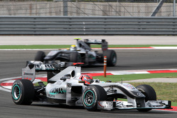 Michael Schumacher, Mercedes GP leads Nico Rosberg, Mercedes GP