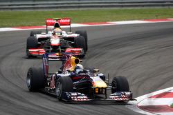 Sebastian Vettel, Red Bull Racing leads Lewis Hamilton, McLaren Mercedes