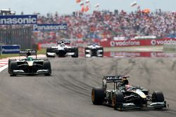 Jarno Trulli, Lotus F1 Team, leads Heikki Kovalainen, Lotus F1 Team