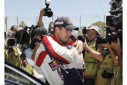 Sébastien Ogier is congratulated by Sébastien Loeb