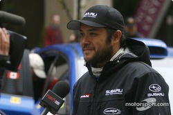 Patrick Richard is interviewed by TSN during the downtown Calgary start of the 2010 Rocky Mountain Rally