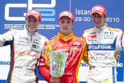Dani Clos celebrates his victory on the podium with Luiz Razia and Giedo Van der Garde