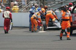 Safety workers assist Raphael Matos, de Ferran Dragon Racing