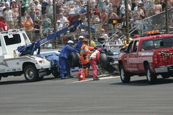 Safety workers clean up the track after the Raphael Matos accident
