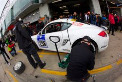 Pit stop for #236 Team DMV Porsche Cayman S: Ivan Jacoma, Nicola Bravetti, Matteo Cassina, André Krumbach