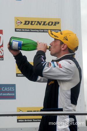 Steven Kane drinks his champagne