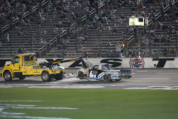 The damaged Chevrolet of Joe Aramendia is hauled off the front straight at Texas Motor Speedway