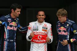 Ganador de la pole position Lewis Hamilton, McLaren Mercedes con Mark Webber, Red Bull Racing segund