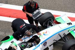 Engineers work on the car of Mihai Marinescu