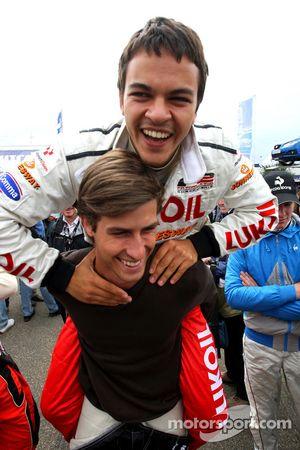 Sergey Afanasiev gets a piggy back from Nicola de Marco