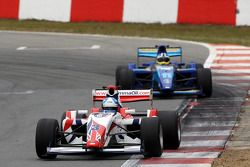 Jolyon Palmer is chased by Jack Clarke