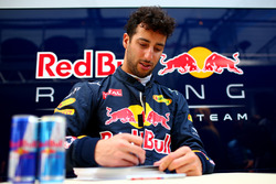 Daniel Ricciardo, Red Bull Racing signs autographs for fans outside the garage
