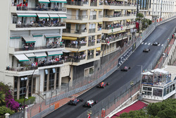 Jenson Button, McLaren MP4-31 and Esteban Gutierrez, Haas F1 Team VF-16