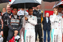 Lewis Hamilton, Mercedes AMG F1 and Sergio Perez, Sahara Force India F1 as the grid observes the national anthem