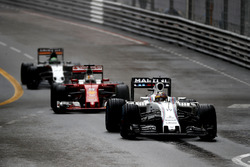 Felipe Massa, Williams FW38, leads Sebastian Vettel, Ferrari SF16-H, and Nico Hulkenberg, Force India VJM09