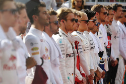 Valtteri Bottas, Williams, and Felipe Massa, Williams, with the rest of the drivers stand during the national anthem