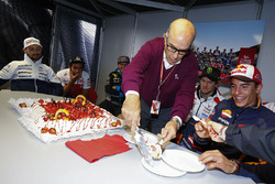 Carmelo Ezpeleta, CEO of Dorna distributes the cake of his 70th birthday among the drivers before the security meeting