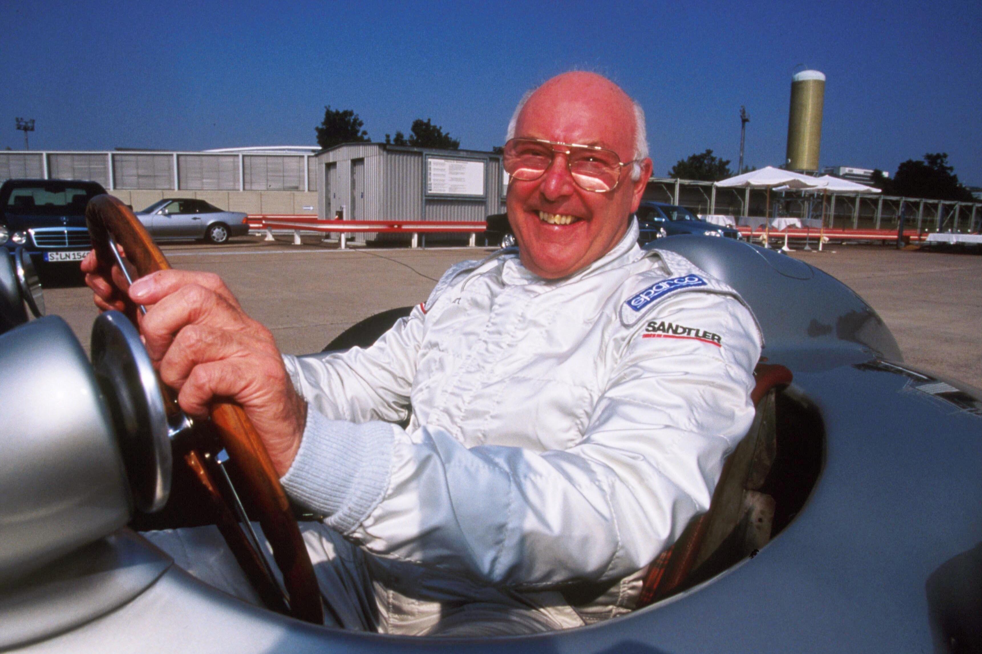 Murray Walker aboard a classic Mercedes in 1999