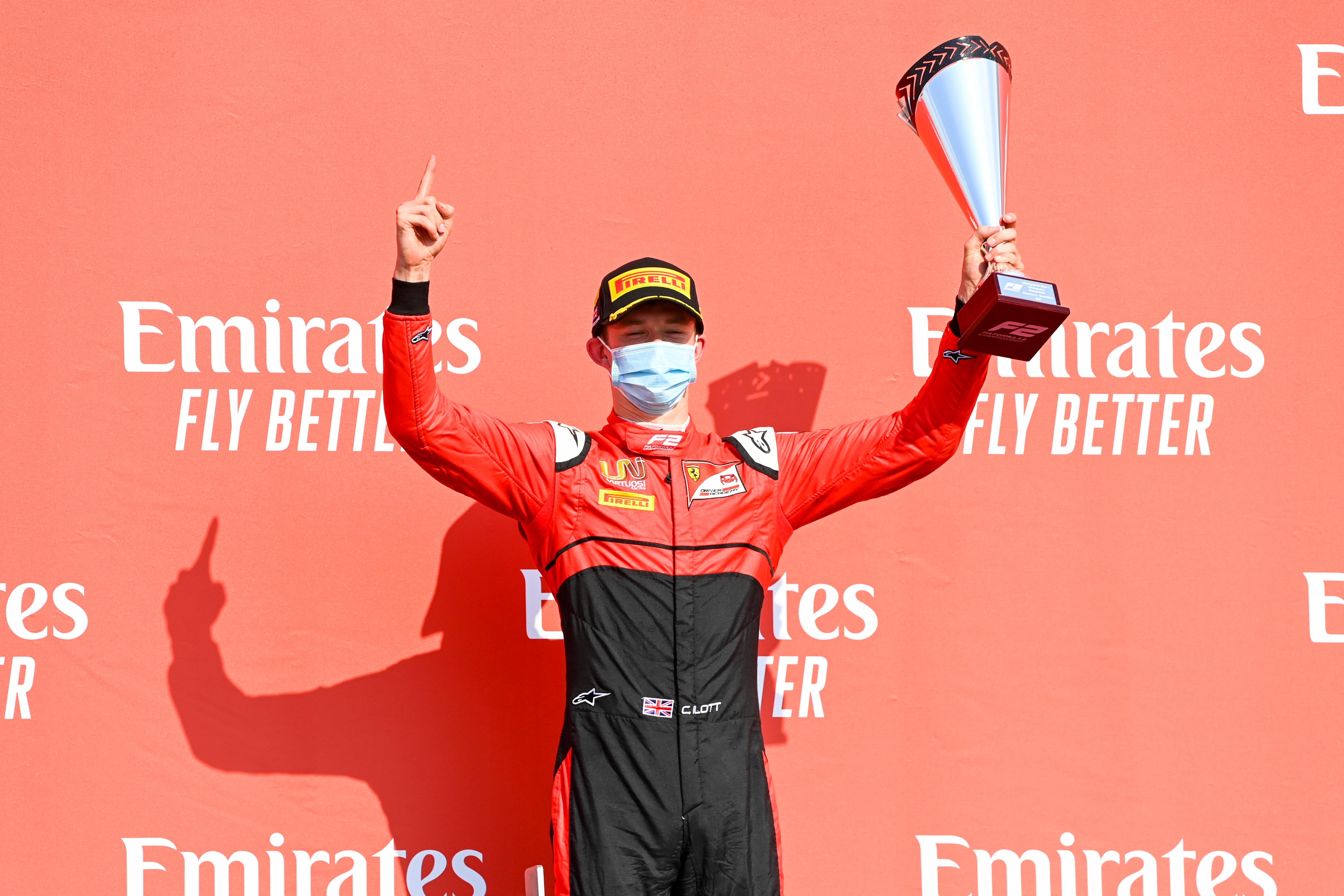 Callum Ilott celebrates winning the FIA F2 feature race at Silverstone in 2020.