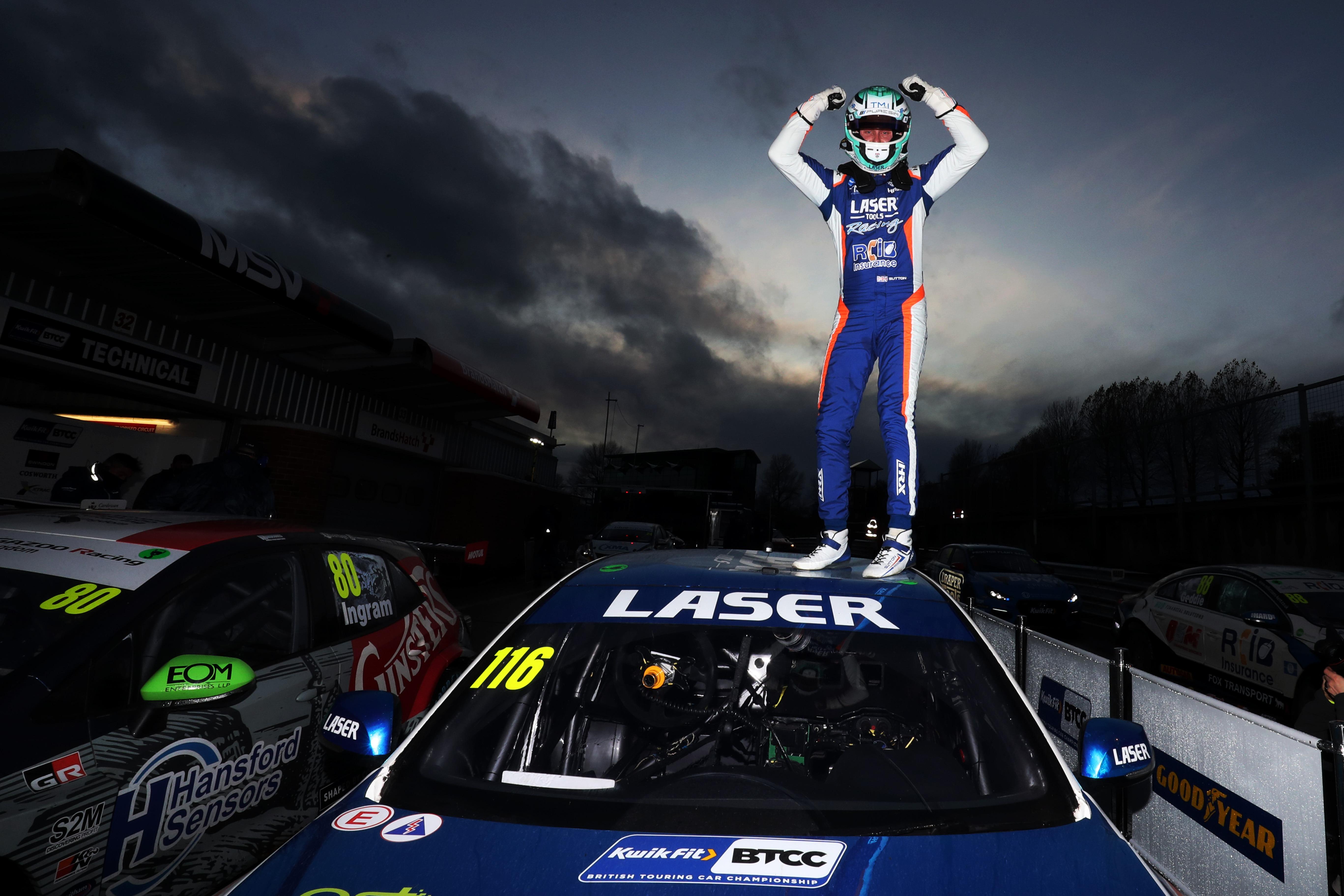 Ash Sutton celebrates after winning the 2020 British Touring Car Championship at Brands Hatch.