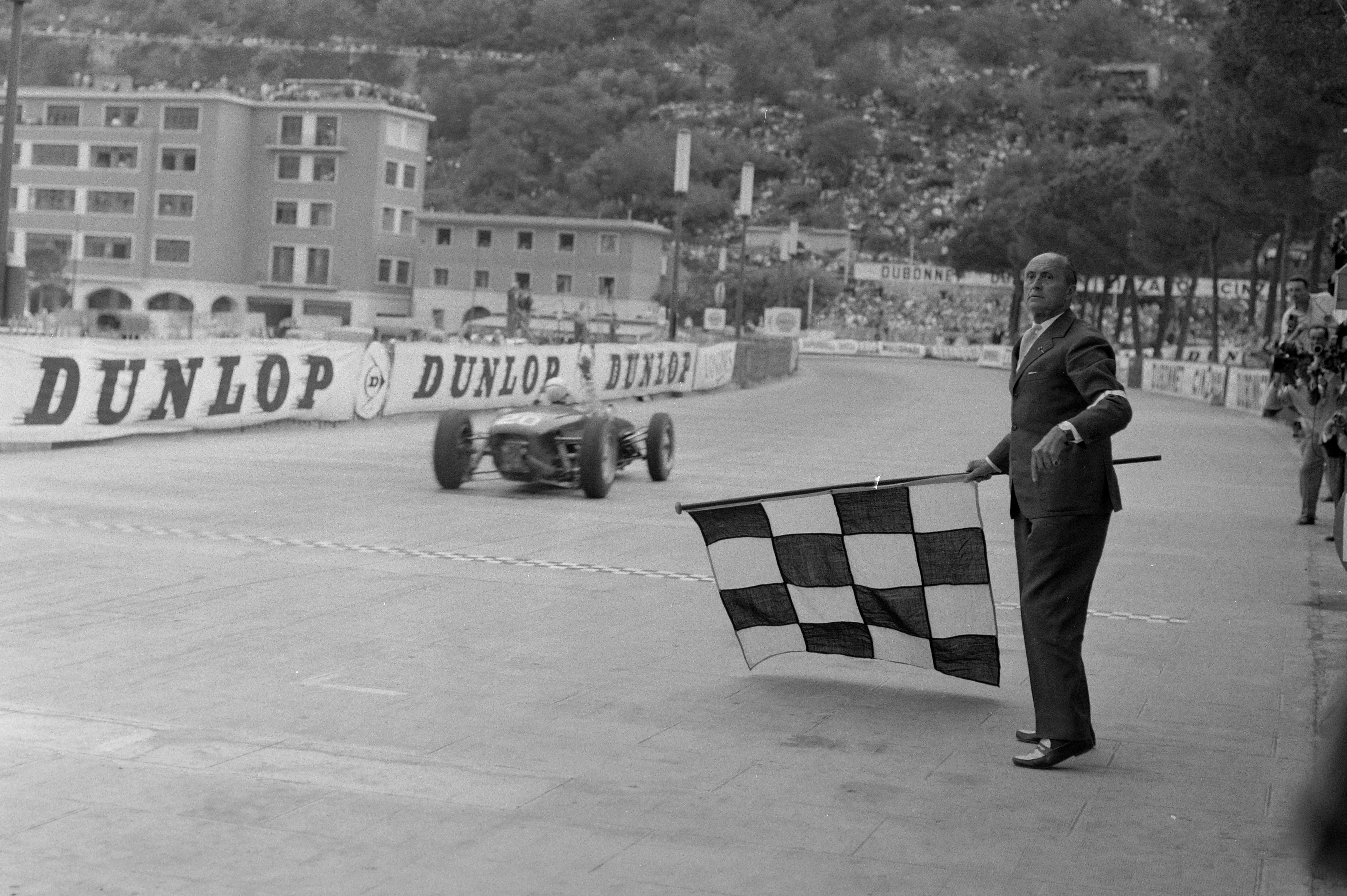 Stirling Moss, 1961 Monaco GP chequered flag