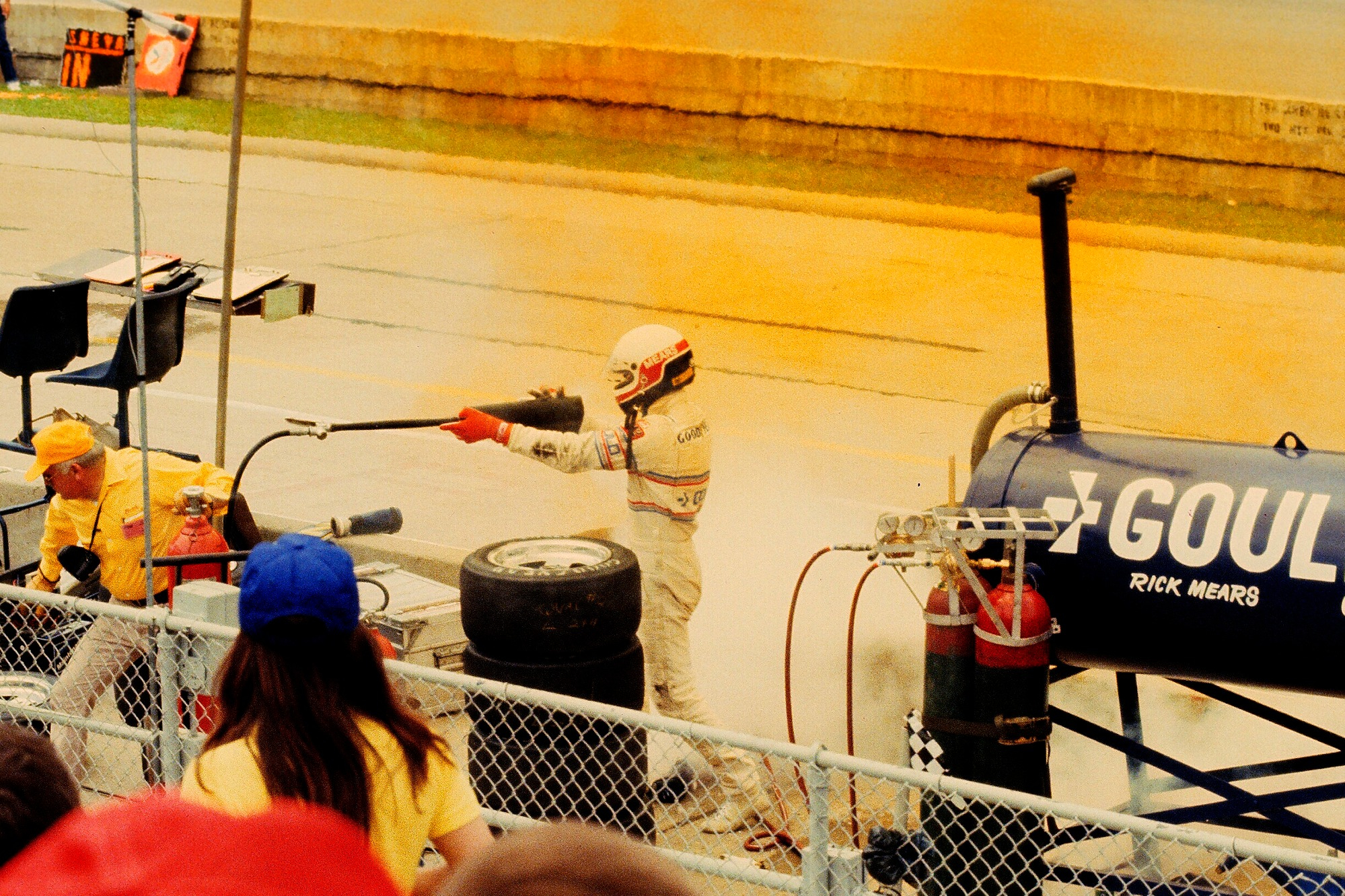 Rick Mears grabs a fire extinguisher at the 1981 Indianapolis 500
