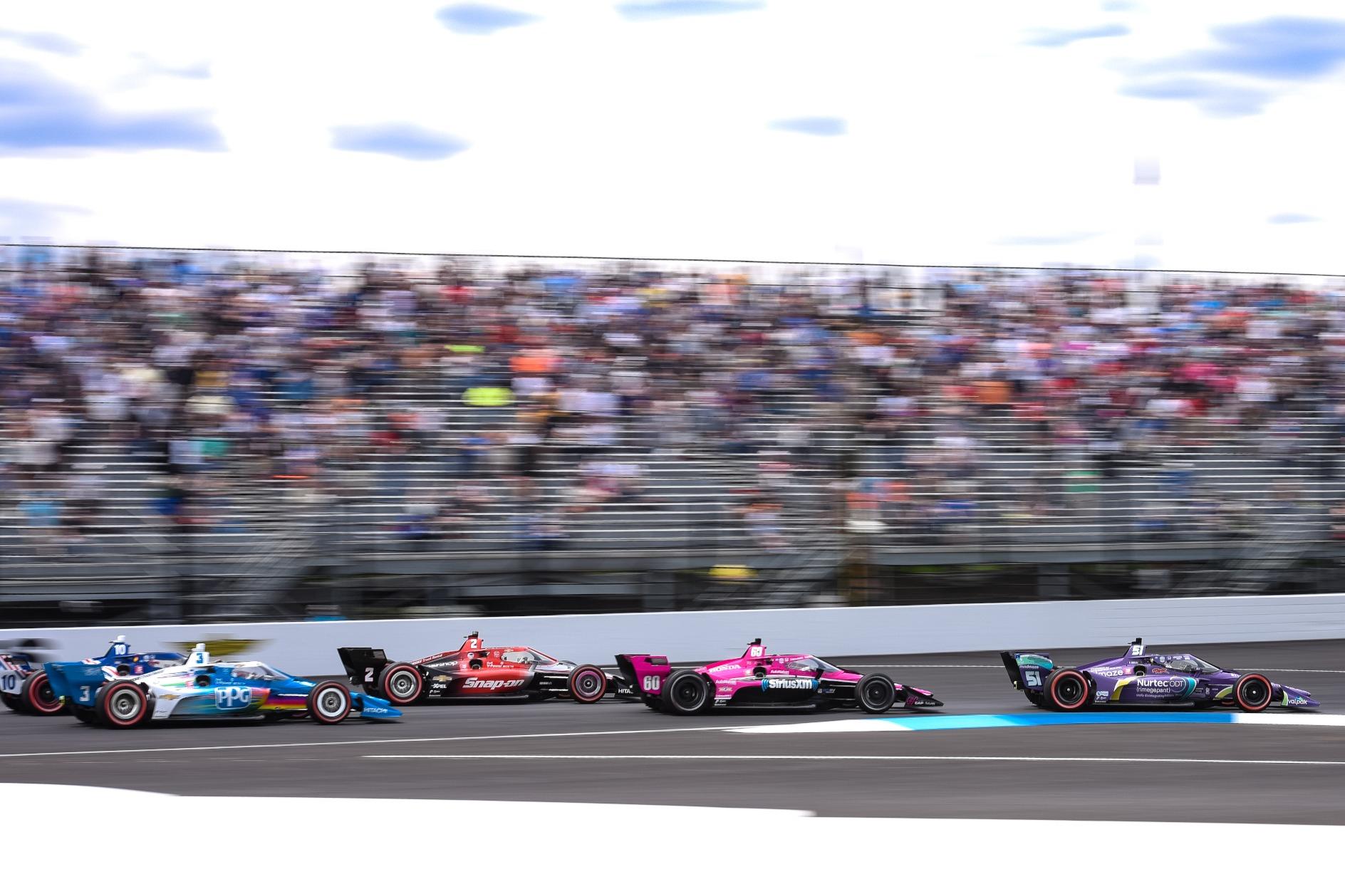 Grosjean leads into Turn 1 at the start