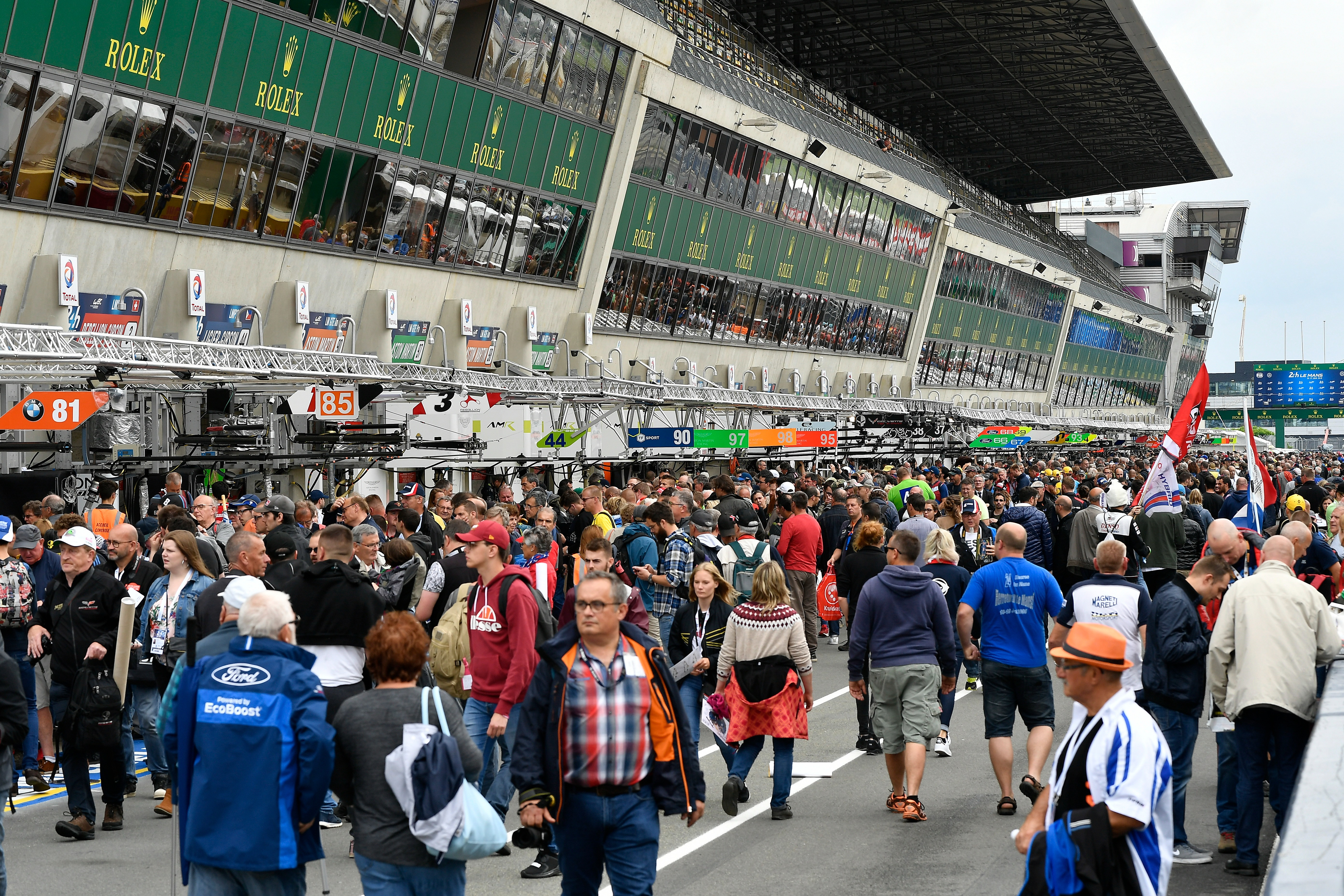 A mass gathering of fans in the Le Mans pitlane in 2018