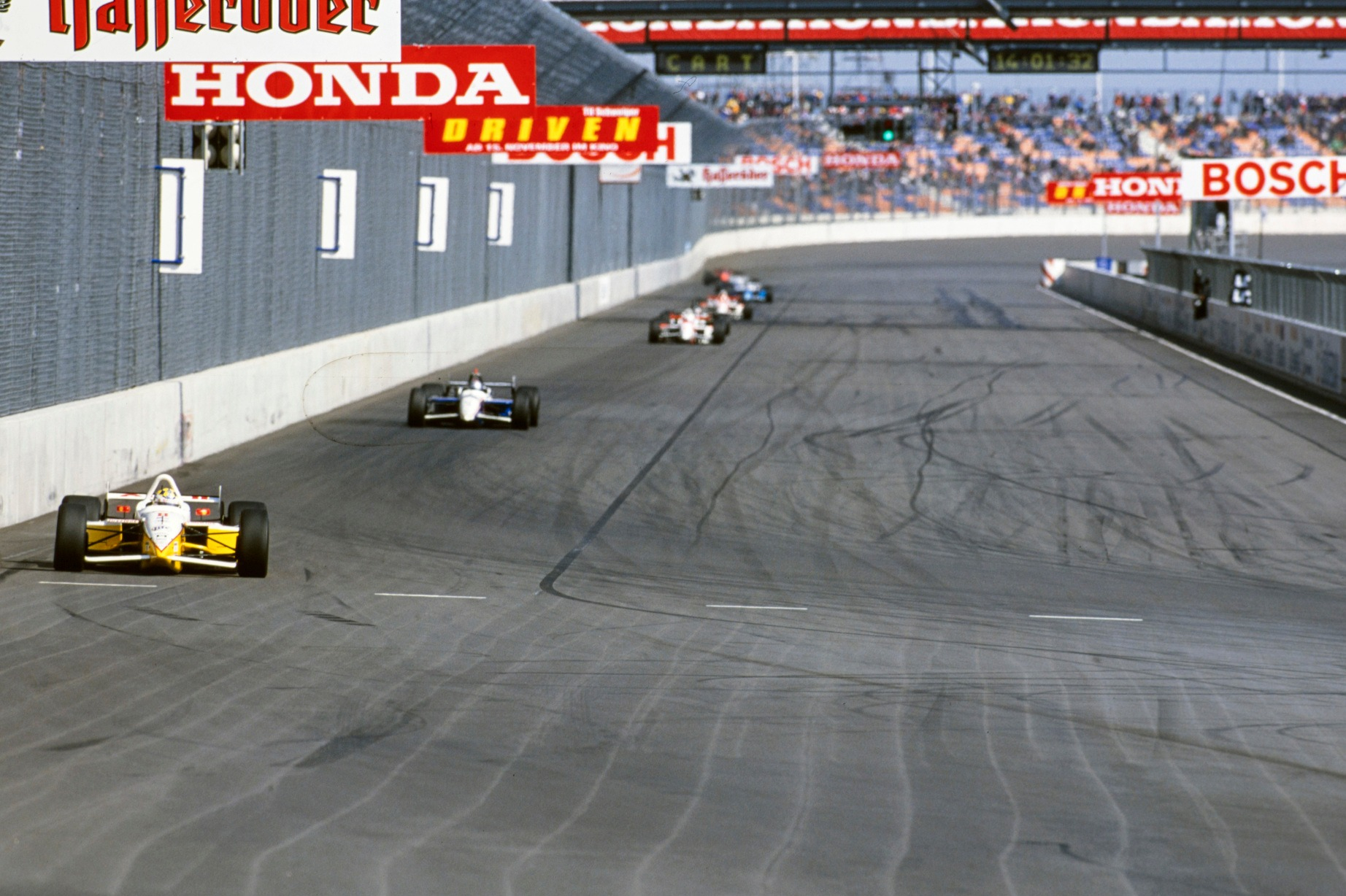 Kenny Brack leads Michael Andretti on the Lausitzring oval in 2001