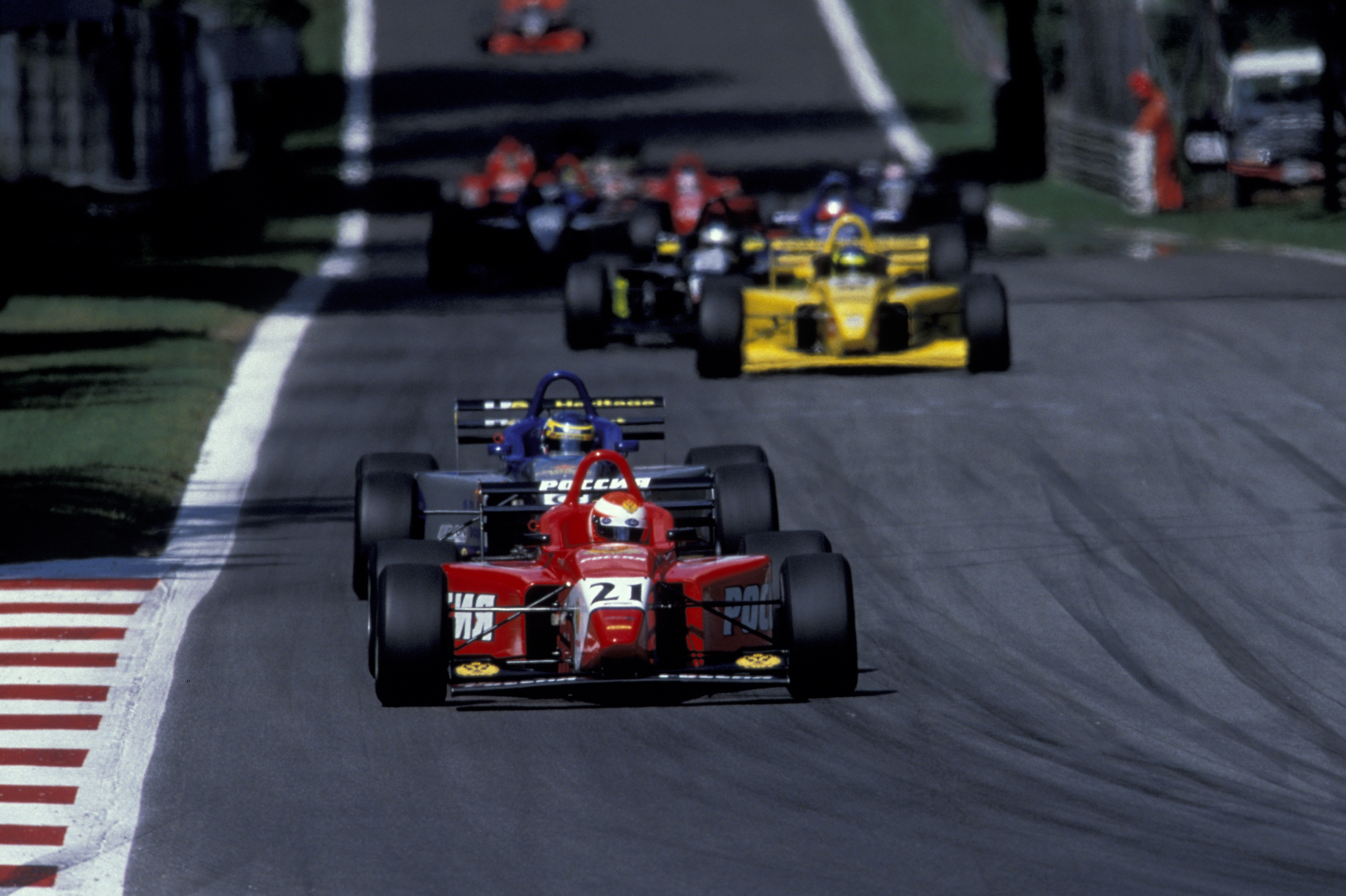 Hughes won at Monza, passing Tomas Scheckter, before being handed the trophy by his 1979 world champion father!
