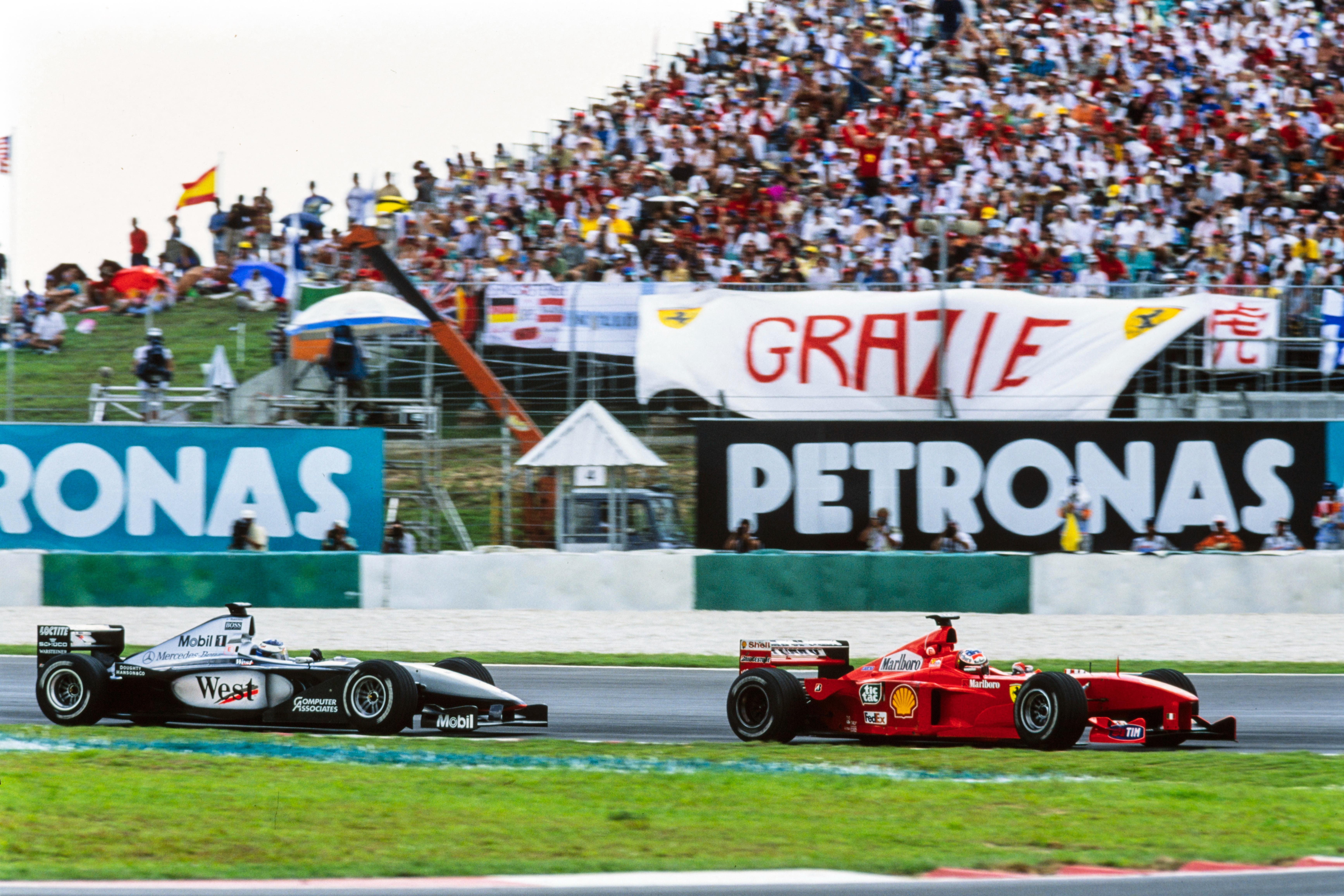 Michael Schumacher, Ferrari F399, leads Mika Häkkinen, McLaren MP4-14 Mercedes.