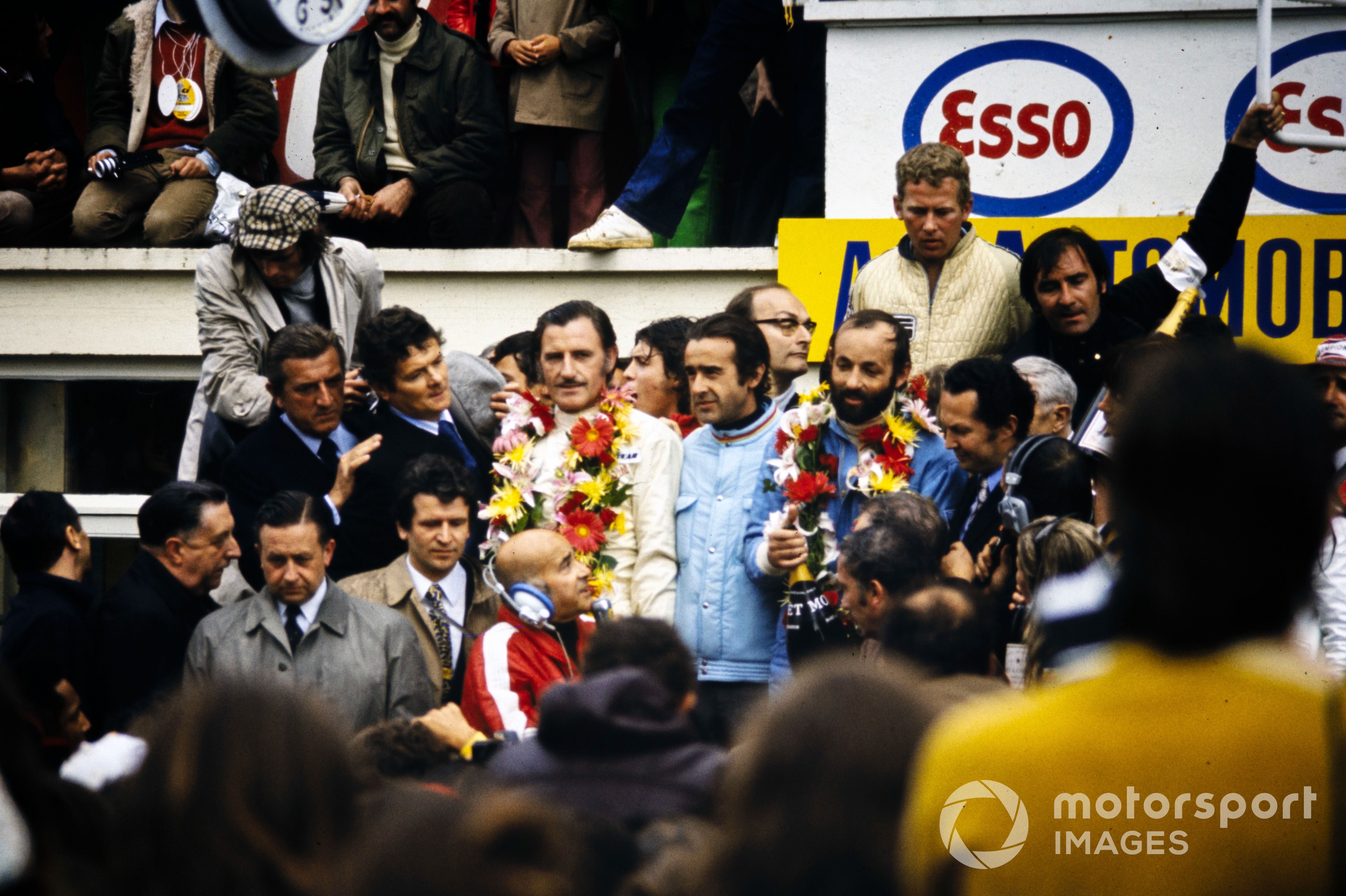 Graham Hill and Henri Pescarolo, 1st position, celebrate on the podium, 1972 Le Mans 24 Hours