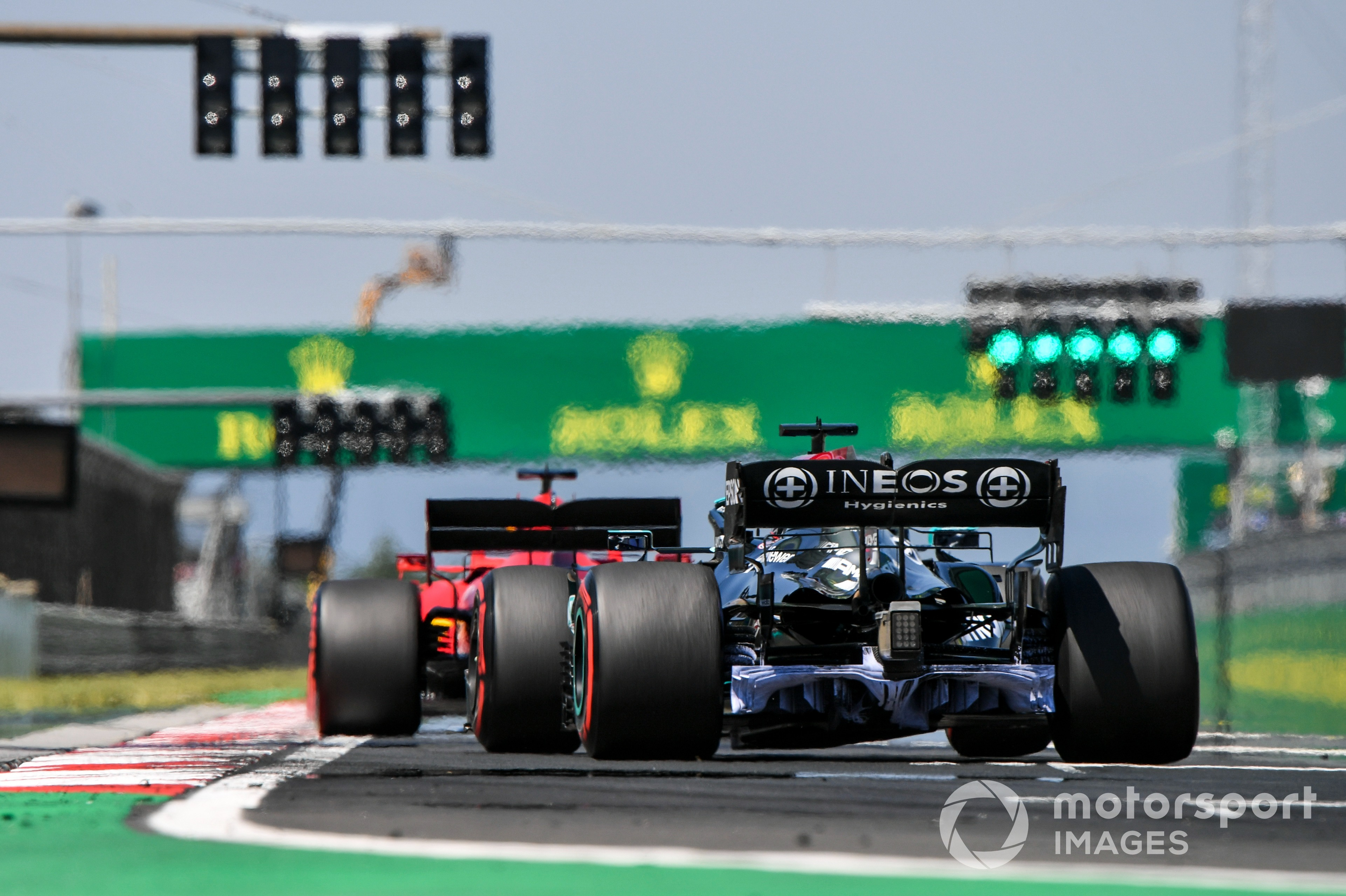 Ferrari's Charles Leclerc leads Lewis Hamilton in the Mercedes, 2021 Hungarian GP