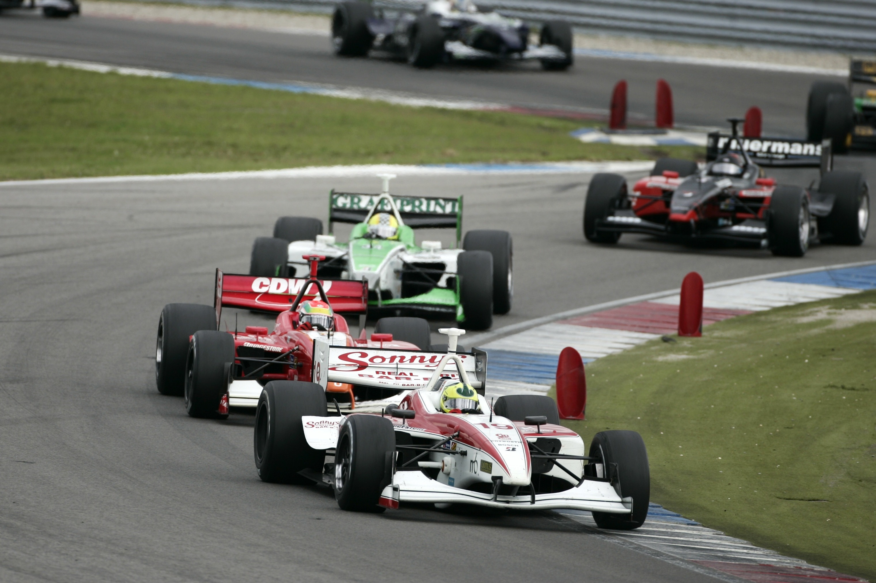 Bruno Junqueira leads Justin Wilson through a chicane at Assen in 2007 in the last season before Champ Car/IRL reunification