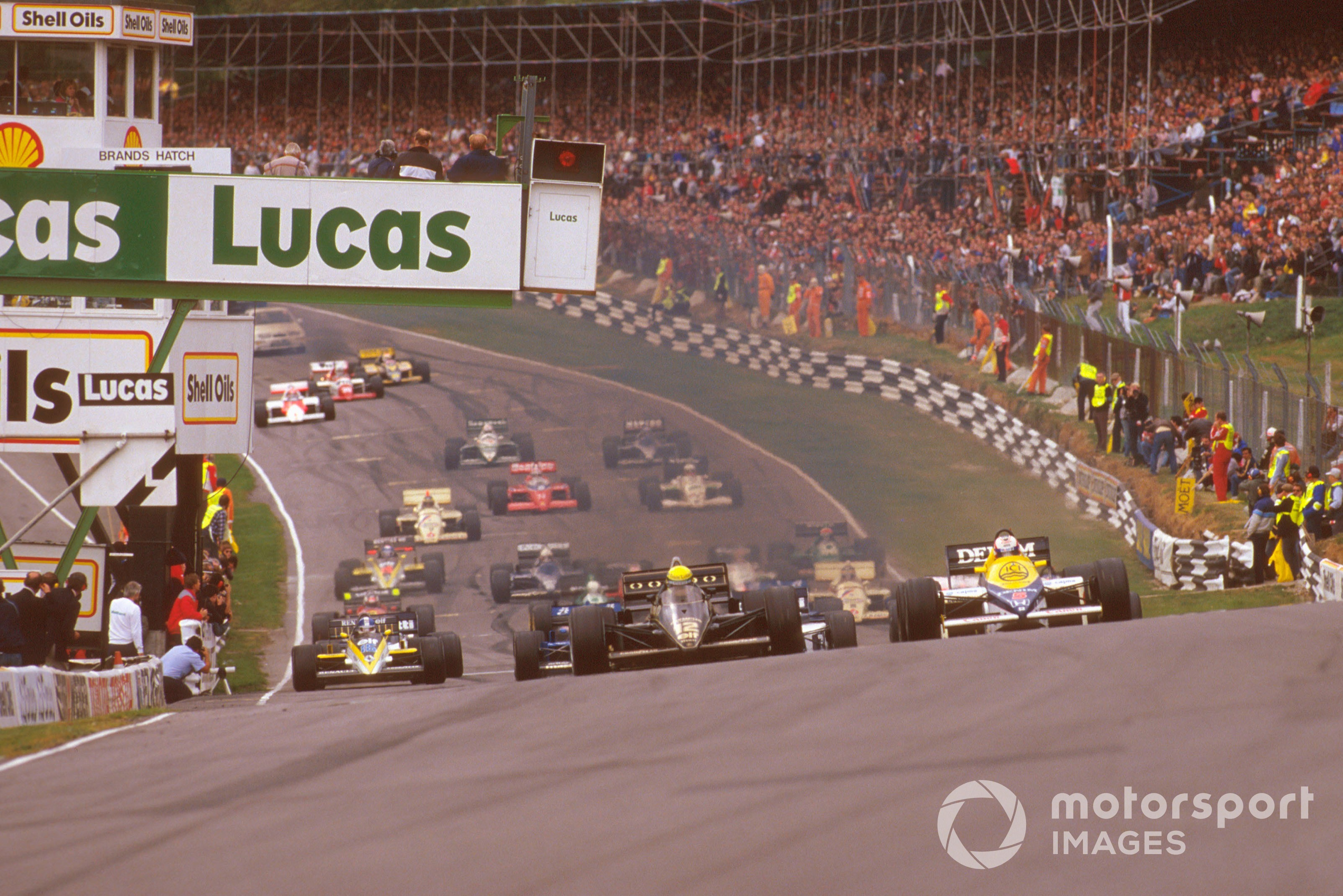 Ayrton Senna in the Lotus-Renault 97T leads the start of the 1985 British GP