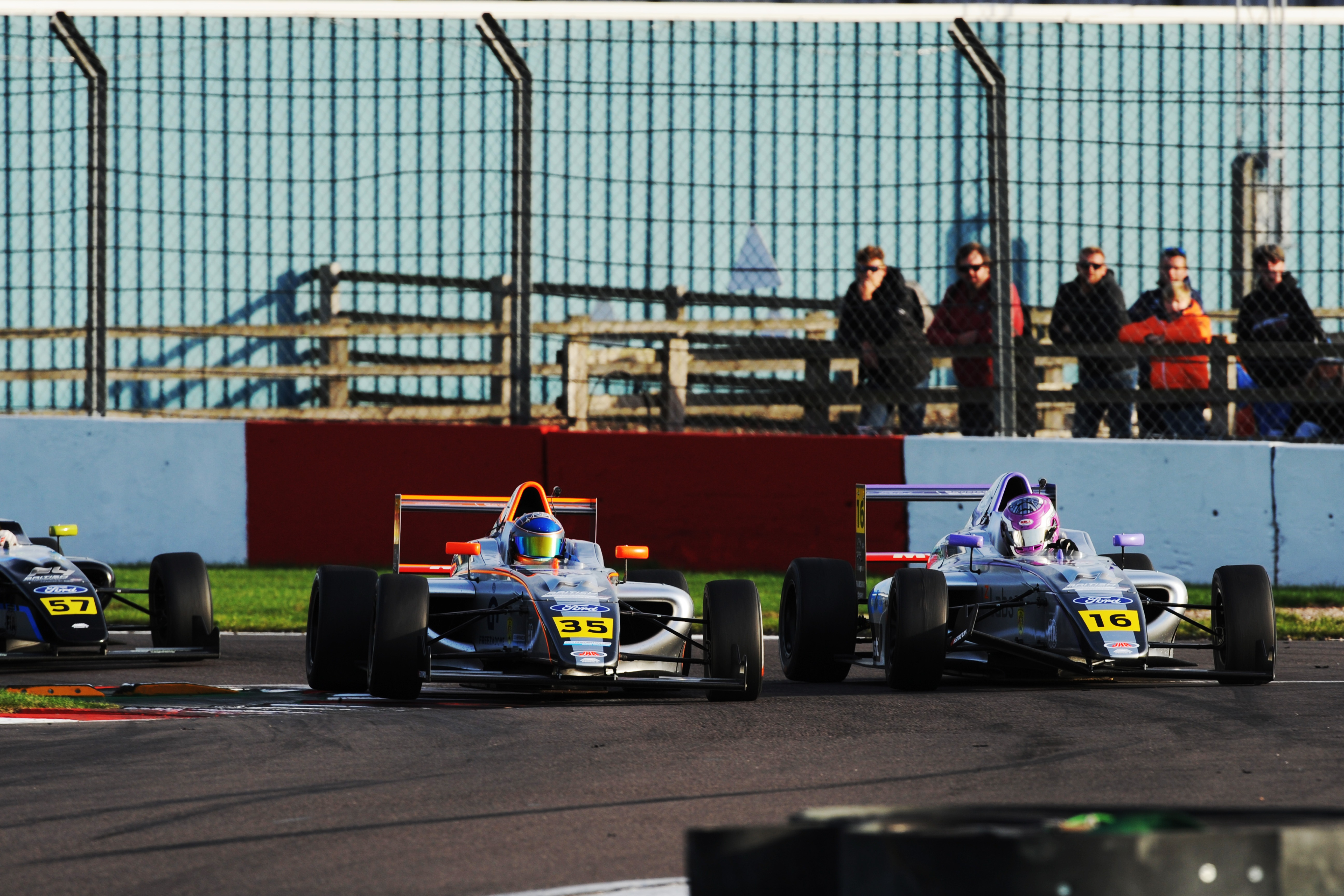 Rees (l) battles JHR team-mate Cresswell en route to British F4 victory