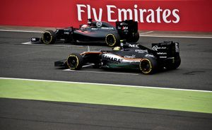 Fernando Alonso (McLaren) and Sergio Perez (Sahara Force India)