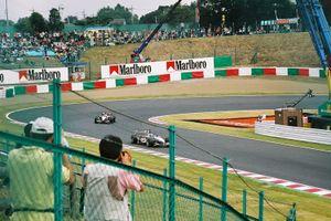 David Coulthard, Kimi Räikkönen on the lap