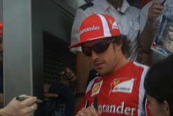 Fernando Alonso doing autographs