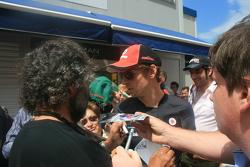 Jenson Button doing autographs