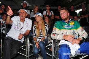 ADAC GT Masters Race 2 - Hans Joachim Stcuk explaining something to a guest