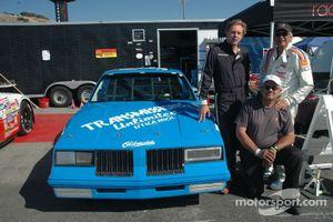 Richard Clark, Bill Alfaro & Mike Cesario pose by the Dave Marcis #71 Historic Nascar Oldsmobile